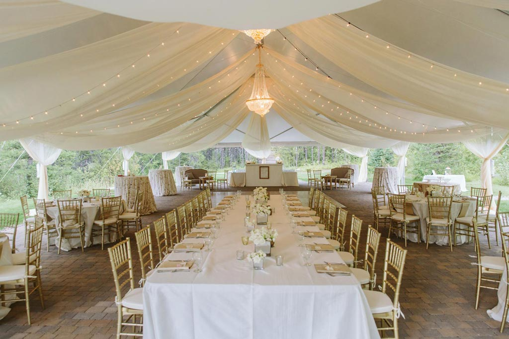 Outdoor tent decorated for a wedding.