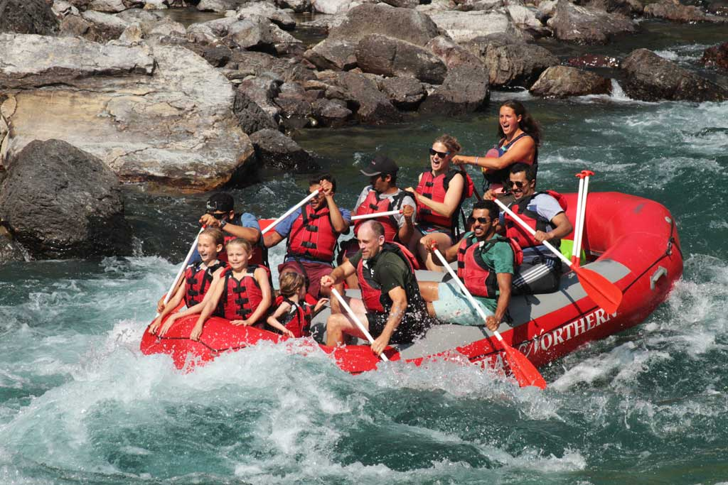 Group of people of all ages on a whitewater rafting trip.